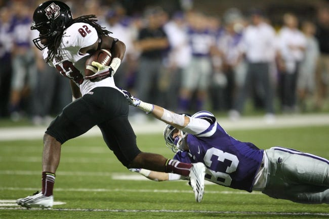 Sep 14, 2013; Manhattan, KS, USA; Massachusetts Minutemen wide receiver D.J. Woods (82) is tackled by Kansas State Wildcats wide receiver Logan Stephens (83) during a punt return at Bill Snyder Family Stadium. The Minutemen lost the game 37-7. Mandatory Credit: Scott Sewell-USA TODAY Sports