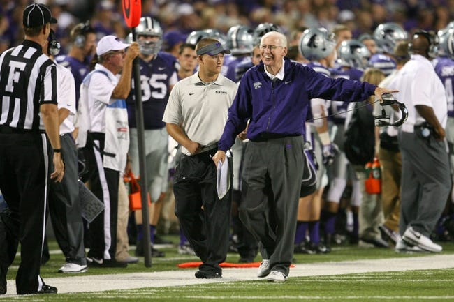 Sep 14, 2013; Manhattan, KS, USA; Kansas State Wildcats head coach Bill Snyder laughs at a call by an official during a 37-7 win against the Massachusetts Minutemen at Bill Snyder Family Stadium. Mandatory Credit: Scott Sewell-USA TODAY Sports