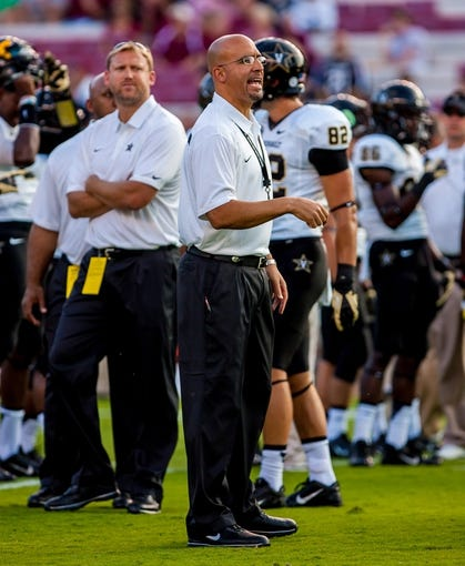 Sep 14, 2013; Columbia, SC, USA; Vanderbilt Commodores head coach James Franklin directs his team in warmups before the game against the South Carolina Gamecocks at Williams-Brice Stadium. Mandatory Credit: Jeff Blake-USA TODAY Sports