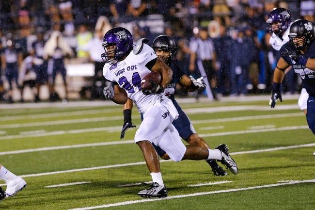 Sep 14, 2013; Logan, UT, USA; Weber State Wildcats running back Josh Booker (24) runs the ball up the field in the 4th quarter at Romney Stadium.  Utah State won 70-6. Mandatory Credit: Chris Nicoll-USA TODAY Sports
