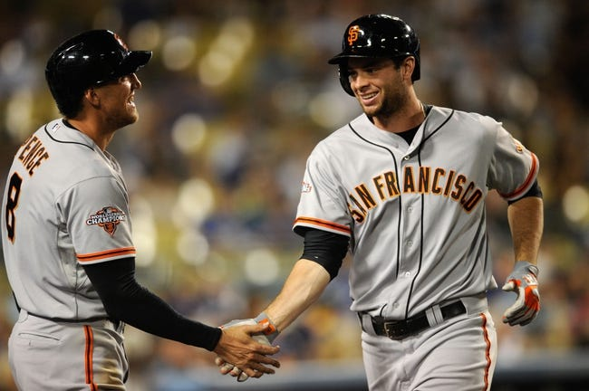 Sep 14, 2013; Los Angeles, CA, USA; San Francisco Giants first baseman Brandon Belt (9) celebrates with San Francisco Giants right fielder Hunter Pence (8) after hitting a home run against the Los Angeles Dodgers during the seventh inning at Dodger Stadium. Mandatory Credit: Kelvin Kuo-USA TODAY Sports