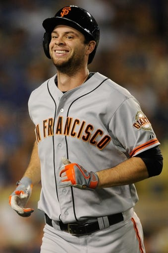 Sep 14, 2013; Los Angeles, CA, USA; San Francisco Giants first baseman Brandon Belt (9) celebrates after hitting a home run against the Los Angeles Dodgers during the seventh inning at Dodger Stadium. Mandatory Credit: Kelvin Kuo-USA TODAY Sports