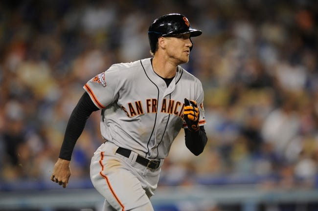 Sep 14, 2013; Los Angeles, CA, USA; San Francisco Giants right fielder Hunter Pence (8) runs the bases after he hits a grand slam against the Los Angeles Dodgers during the fifth inning at Dodger Stadium. Mandatory Credit: Kelvin Kuo-USA TODAY Sports