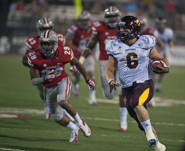 Sep 14, 2013; Las Vegas, NV, USA; Central Michigan Chippewas running back Saylor Lavallii (6) runs with the ball for a large gain during the first half of an NCAA football game against the UNLV Rebels at Sam Boyd Stadium. Mandatory Credit: Stephen R. Sylvanie-USA TODAY Sports