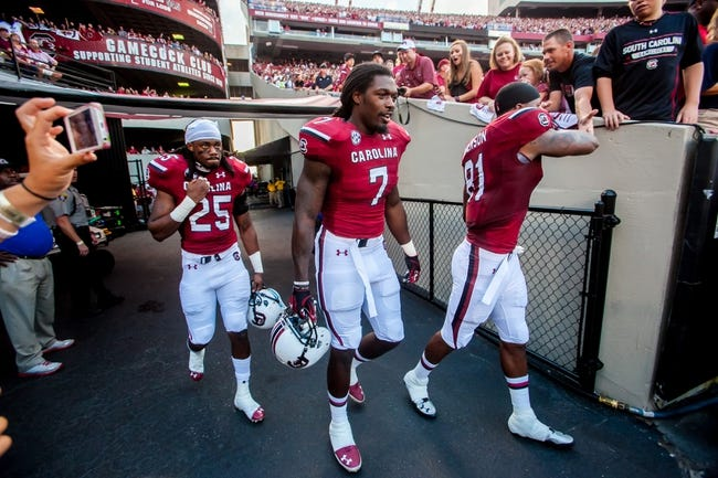 Sep 14, 2013; Columbia, SC, USA; South Carolina Gamecocks safety Kadetrix Marcus (25) and South Carolina Gamecocks defensive end Jadeveon Clowney (7) and South Carolina Gamecocks tight end Rory Anderson (81) walk onto the field for the coin flip against the Vanderbilt Commodores at Williams-Brice Stadium. Mandatory Credit: Jeff Blake-USA TODAY Sports