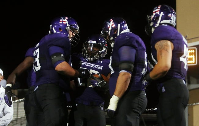 Sep 14, 2013; Evanston, IL, USA; Northwestern Wildcats running back Treyvon Green (22) celebrates with teammates after scoring a touchdown against the Western Michigan Broncos during the fourth quarter at Ryan Field. Mandatory Credit: Jerry Lai-USA TODAY Sports