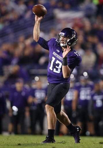 Sep 14, 2013; Evanston, IL, USA; Northwestern Wildcats quarterback Trevor Siemian (13) throws a pass against the Western Michigan Broncos during the third quarter at Ryan Field. Mandatory Credit: Jerry Lai-USA TODAY Sports