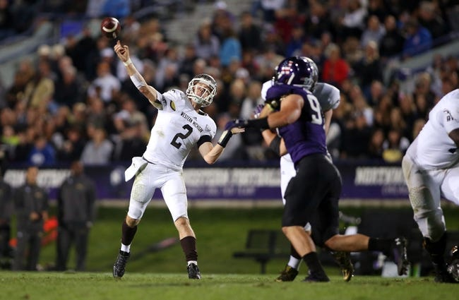 Sep 14, 2013; Evanston, IL, USA; Western Michigan Broncos quarterback Tyler Van Tubbergen (2) throws a touchdown pass against the Northwestern Wildcats during the third quarter at Ryan Field. Mandatory Credit: Jerry Lai-USA TODAY Sports
