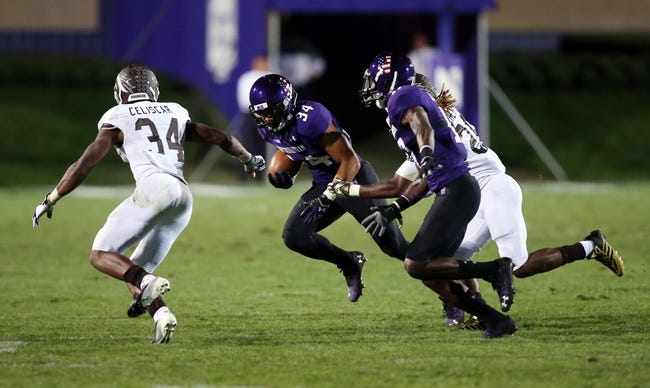 Sep 14, 2013; Evanston, IL, USA; Northwestern Wildcats running back Warren Long (34) runs with the ball against Western Michigan Broncos cornerback Donald Celiscar (34) during the fourth quarter at Ryan Field. Mandatory Credit: Jerry Lai-USA TODAY Sports
