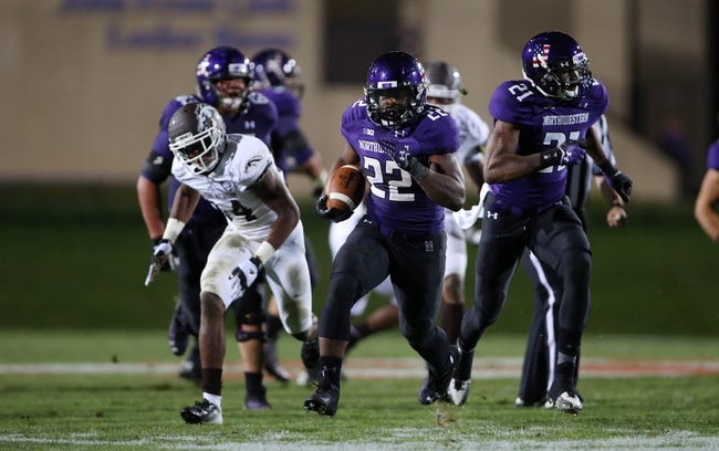 Sep 14, 2013; Evanston, IL, USA; Northwestern Wildcats running back Treyvon Green (22) runs for a touchdown against the Western Michigan Broncos during the fourth quarter at Ryan Field. Mandatory Credit: Jerry Lai-USA TODAY Sports