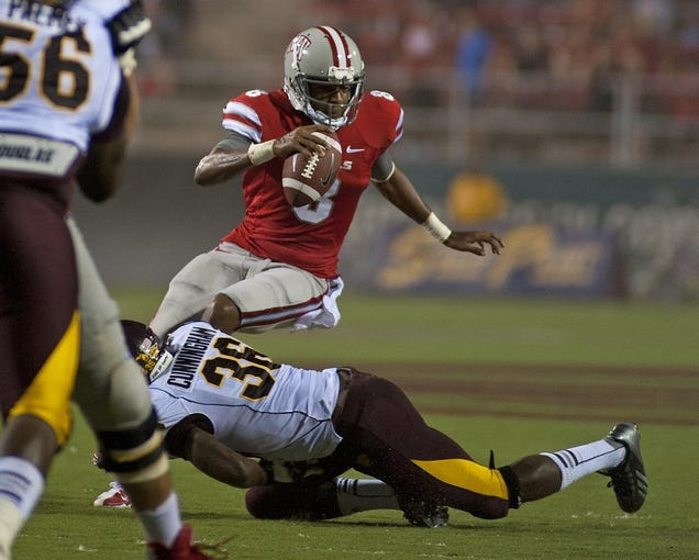 Sep 14, 2013; Las Vegas, NV, USA; UNLV Rebels quarterback Caleb Herring is sacked by Central Michigan defensive back Avery Cunningham during an NCAA football game at Sam Boyd Stadium. Mandatory Credit: Stephen R. Sylvanie-USA TODAY Sports
