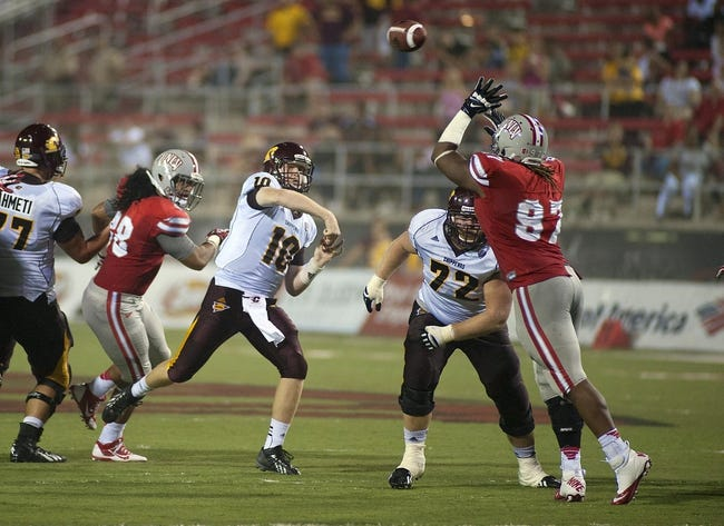Sep 14, 2013; Las Vegas, NV, USA; Central Michigan Chippewas quarterback Cooper Rush (10) makes a fourth quarter pass attempt against the UNLV Rebels during an NCAA football game at Sam Boyd Stadium. UNLV won the game 31-21. Mandatory Credit: Stephen R. Sylvanie-USA TODAY Sports