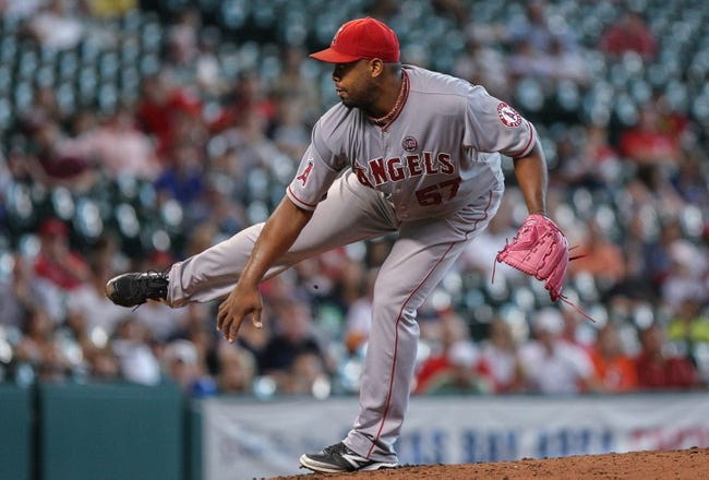 Sep 15, 2013; Houston, TX, USA; Los Angeles Angels starting pitcher Jerome Williams (57) pitches during the third inning against the Houston Astros at Minute Maid Park. Mandatory Credit: Troy Taormina-USA TODAY Sports