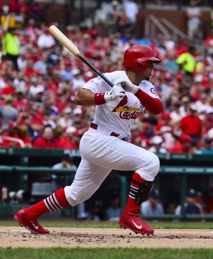 Sep 15, 2013; St. Louis, MO, USA; St. Louis Cardinals center fielder Jon Jay (19) hits a single against the Seattle Mariners at Busch Stadium. Mandatory Credit: Scott Rovak-USA TODAY Sports