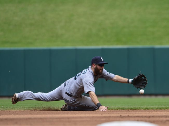 Sep 15, 2013; St. Louis, MO, USA; Seattle Mariners second baseman Dustin Ackley (13) makes a play against the St. Louis Cardinals at Busch Stadium. Mandatory Credit: Scott Rovak-USA TODAY Sports