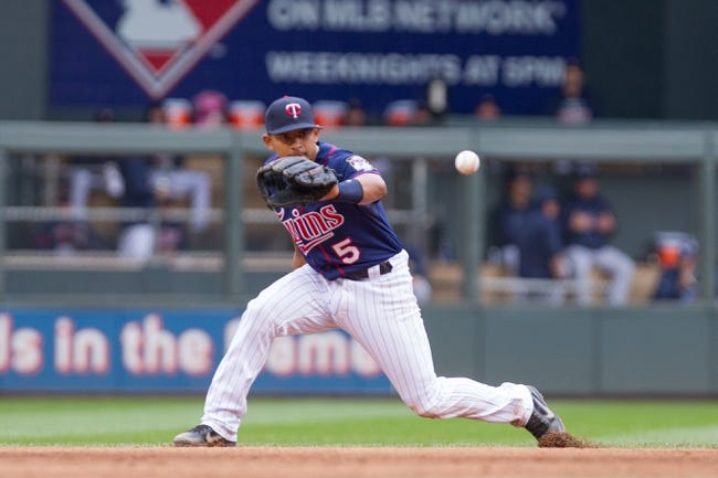 Sep 15, 2013; Minneapolis, MN, USA; The Minnesota Twins infielder Eduardo Escobar (5) catches an infield hit in the sixth inning against the Tampa Bay Rays at Target Field. Mandatory Credit: Brad Rempel-USA TODAY Sports