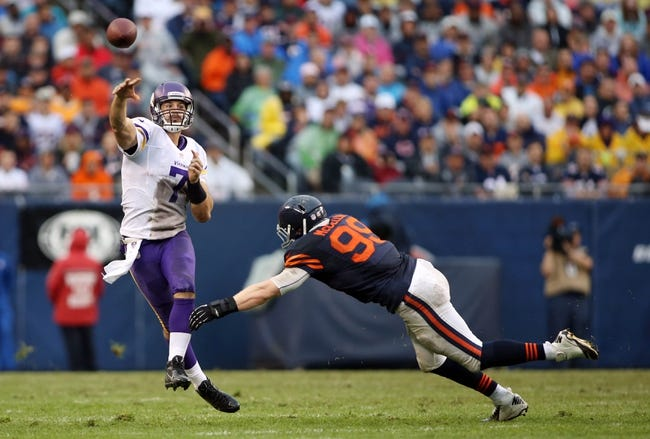 Sep 15, 2013; Chicago, IL, USA; Minnesota Vikings quarterback Christian Ponder (7) throws a pass while pressured by Chicago Bears defensive end Shea McClellin (99) during the fourth quarter at Soldier Field. The Bears won 31-30. Mandatory Credit: Jerry Lai-USA TODAY Sports