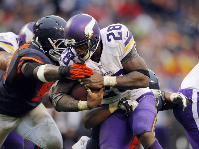 Sep 15, 2013; Chicago, IL, USA; Minnesota Vikings running back Adrian Peterson (28) is tackled by Chicago Bears middle linebacker D.J. Williams (58) during the second half at Soldier Field. Chicago won 31-30. Mandatory Credit: Dennis Wierzbicki-USA TODAY Sports