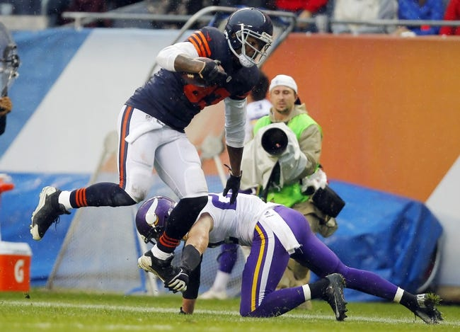 Sep 15, 2013; Chicago, IL, USA; Chicago Bears tight end Martellus Bennett (83) leaps over Minnesota Vikings free safety Harrison Smith (22) during the second half at Soldier Field. Chicago won 31-30. Mandatory Credit: Dennis Wierzbicki-USA TODAY Sports