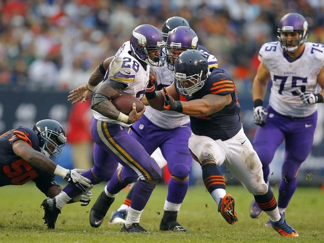 Sep 15, 2013; Chicago, IL, USA; Minnesota Vikings running back Adrian Peterson (28) is tackled by Chicago Bears defensive tackle Stephen Paea (92) during the second half at Soldier Field. Chicago won 31-30. Mandatory Credit: Dennis Wierzbicki-USA TODAY Sports