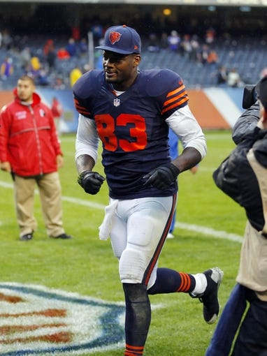 Sep 15, 2013; Chicago, IL, USA; Chicago Bears tight end Martellus Bennett (83) runs off the field after the game against the Minnesota Vikings at Soldier Field. Chicago won 31-30. Mandatory Credit: Dennis Wierzbicki-USA TODAY Sports