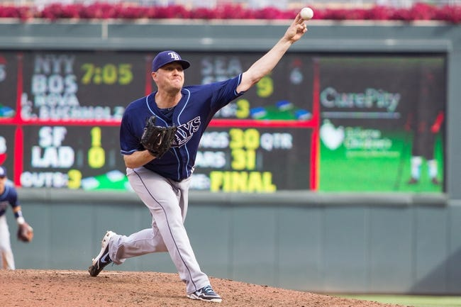 Sep 15, 2013; Minneapolis, MN, USA; The Tampa Bay Rays pitcher Jake McGee (57) throws the ball in the seventh inning against the Minnesota Twins at Target Field. Mandatory Credit: Brad Rempel-USA TODAY Sports