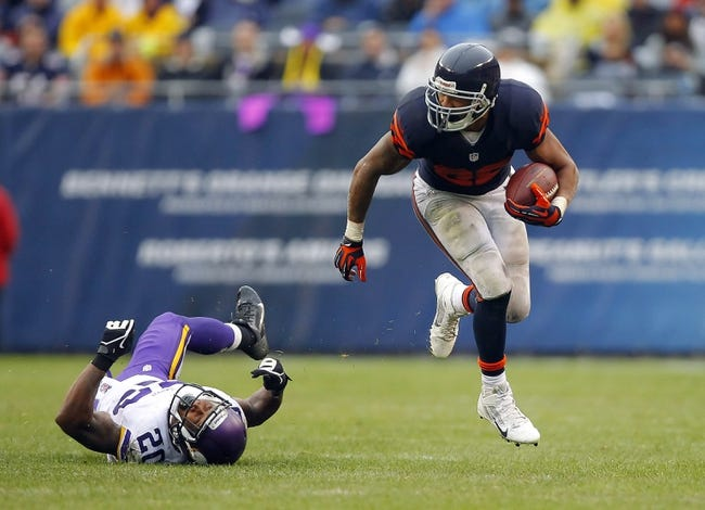 Sep 15, 2013; Chicago, IL, USA; Chicago Bears running back Matt Forte (22) runs past Minnesota Vikings cornerback Chris Cook (20) during the second half at Soldier Field. Chicago won 31-30. Mandatory Credit: Dennis Wierzbicki-USA TODAY Sports