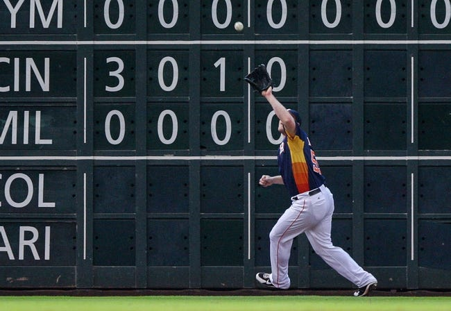 Sep 15, 2013; Houston, TX, USA; Houston Astros left fielder Marc Krauss (59) catches a fly ball during the fifth inning against the Los Angeles Angels at Minute Maid Park. Mandatory Credit: Troy Taormina-USA TODAY Sports