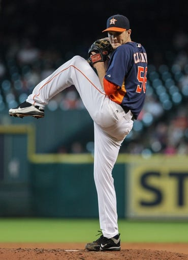 Sep 15, 2013; Houston, TX, USA; Houston Astros relief pitcher Paul Clemens (56) pitches during the sixth inning against the Los Angeles Angels at Minute Maid Park. Mandatory Credit: Troy Taormina-USA TODAY Sports