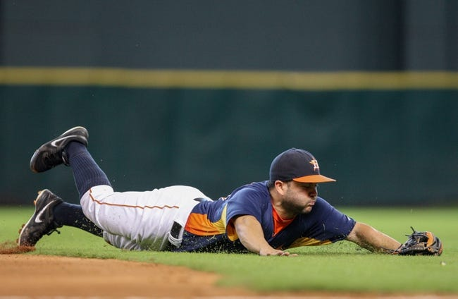 Sep 15, 2013; Houston, TX, USA; Houston Astros second baseman Jose Altuve (27) dives for a ground ball during the fifth inning against the Los Angeles Angels at Minute Maid Park. Mandatory Credit: Troy Taormina-USA TODAY Sports