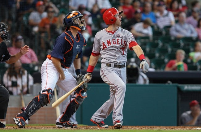 Sep 15, 2013; Houston, TX, USA; Los Angeles Angels shortstop Andrew Romine (7) hits a sacrifice fly during the fifth inning against the Houston Astros at Minute Maid Park. Mandatory Credit: Troy Taormina-USA TODAY Sports