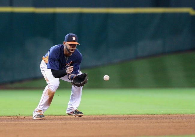 Sep 15, 2013; Houston, TX, USA; Houston Astros shortstop Jonathan Villar (6) fields a ground ball during the seventh inning against the Los Angeles Angels at Minute Maid Park. Mandatory Credit: Troy Taormina-USA TODAY Sports