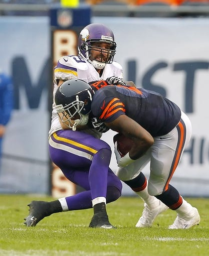 Sep 15, 2013; Chicago, IL, USA; Chicago Bears wide receiver Alshon Jeffery (17) is tackled by Minnesota Vikings defensive end Jared Allen (69) during the second half at Soldier Field. Chicago won 31-30. Mandatory Credit: Dennis Wierzbicki-USA TODAY Sports