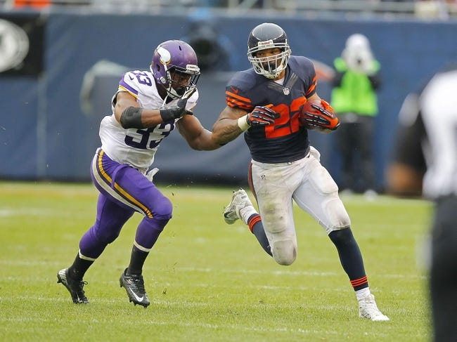 Sep 15, 2013; Chicago, IL, USA; Chicago Bears running back Matt Forte (22) is pursued by Minnesota Vikings strong safety Jamarca Sanford (33) during the second half at Soldier Field. Chicago won 31-30. Mandatory Credit: Dennis Wierzbicki-USA TODAY Sports