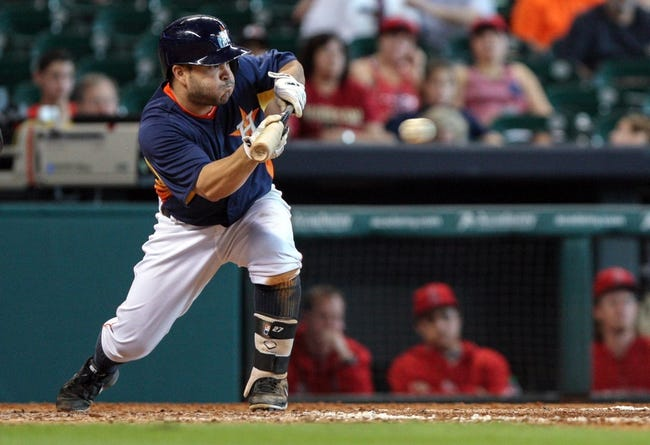 Sep 15, 2013; Houston, TX, USA; Houston Astros second baseman Jose Altuve (27) bunts during the eighth inning against the Los Angeles Angels at Minute Maid Park. Mandatory Credit: Troy Taormina-USA TODAY Sports