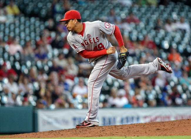Sep 15, 2013; Houston, TX, USA; Los Angeles Angels relief pitcher Ernesto Frieri (49) pitches during the eighth inning against the Houston Astros at Minute Maid Park. Mandatory Credit: Troy Taormina-USA TODAY Sports