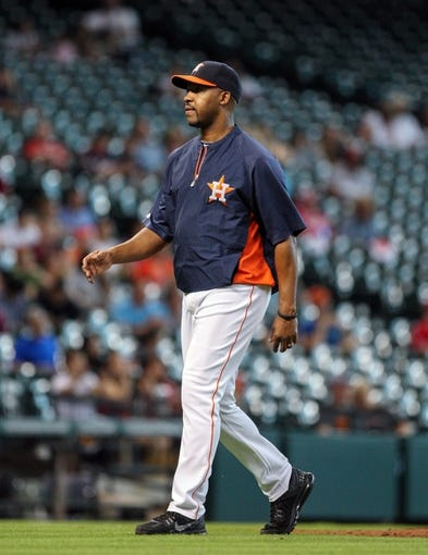 Sep 15, 2013; Houston, TX, USA; Houston Astros manager Bo Porter (16) walks to the dugout during the ninth inning against the Los Angeles Angels at Minute Maid Park. Mandatory Credit: Troy Taormina-USA TODAY Sports