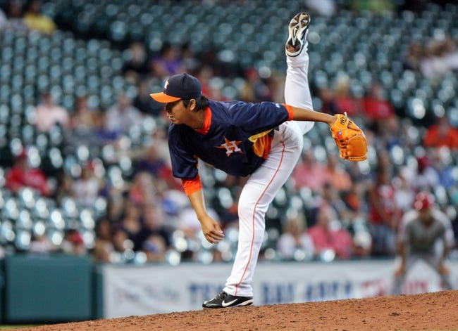 Sep 15, 2013; Houston, TX, USA; Houston Astros relief pitcher Chia-Jen Lo (63) pitches during the ninth inning against the Los Angeles Angels at Minute Maid Park. Mandatory Credit: Troy Taormina-USA TODAY Sports