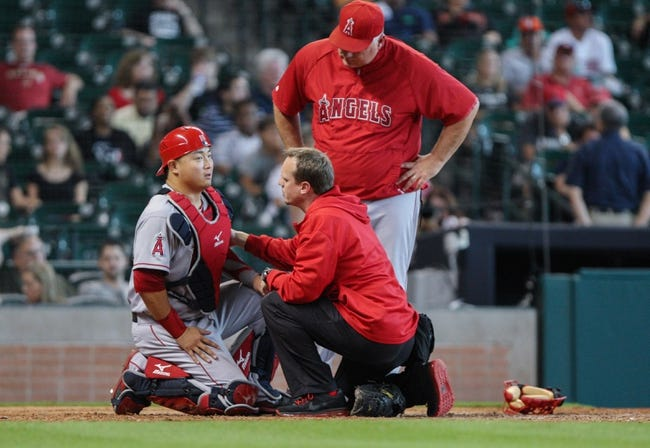 Sep 15, 2013; Houston, TX, USA; Los Angeles Angels catcher Hank Conger (16) is evaluated by medical staff during the ninth inning against the Houston Astros at Minute Maid Park. Mandatory Credit: Troy Taormina-USA TODAY Sports