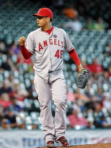 Sep 15, 2013; Houston, TX, USA; Los Angeles Angels relief pitcher Ernesto Frieri (49) reacts after getting the final out to defeat the Houston Astros 2-1 at Minute Maid Park. Mandatory Credit: Troy Taormina-USA TODAY Sports