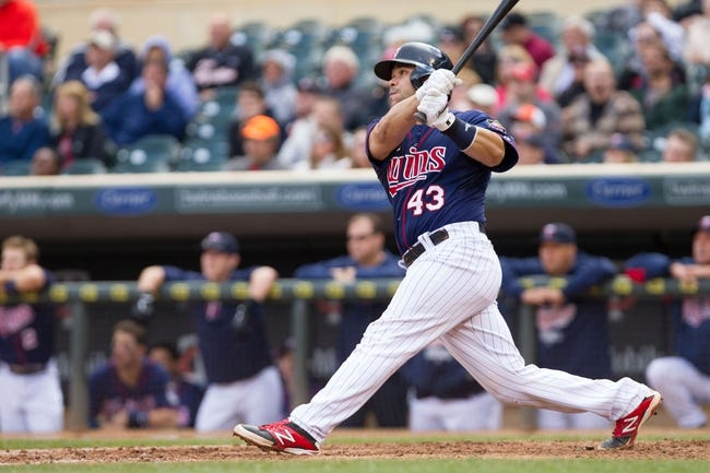 Sep 15, 2013; Minneapolis, MN, USA; The Minnesota Twins catcher Josmil Pinto (43) hits a home run in the eighth inning against the Tampa Bay Rays at Target Field. The Twins won 6-4. Mandatory Credit: Brad Rempel-USA TODAY Sports
