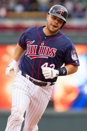 Sep 15, 2013; Minneapolis, MN, USA; The Minnesota Twins catcher Josmil Pinto (43) rounds third base after hitting a home run in the eighth inning against the Tampa Bay Rays at Target Field. The Twins won 6-4. Mandatory Credit: Brad Rempel-USA TODAY Sports