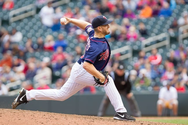 Sep 15, 2013; Minneapolis, MN, USA; The Minnesota Twins pitcher Glen Perkins (15) throws a pitch in the ninth inning against the Tampa Bay Rays at Target Field. Twins win 6-4. Mandatory Credit: Brad Rempel-USA TODAY Sports