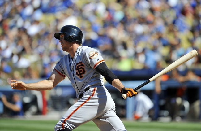 September 15, 2013; Los Angeles, CA, USA; San Francisco Giants right fielder Hunter Pence (8) at bat during the fourth inning against the Los Angeles Dodgers at Dodger Stadium. Pence would be out on this at bat. Mandatory Credit: Gary A. Vasquez-USA TODAY Sports