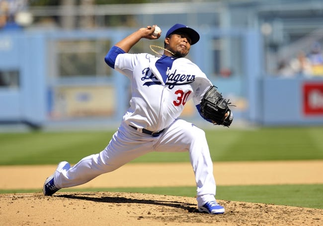 September 15, 2013; Los Angeles, CA, USA; Los Angeles Dodgers relief pitcher Edinson Volquez (30) pitches during the fourth inning against the San Francisco Giants at Dodger Stadium. Mandatory Credit: Gary A. Vasquez-USA TODAY Sports