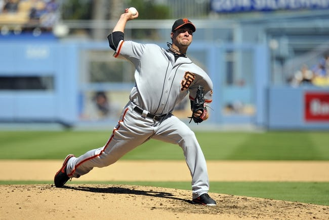 September 15, 2013; Los Angeles, CA, USA; San Francisco Giants starting pitcher Ryan Vogelsong (32) pitches during the fourth inning against the Los Angeles Dodgers at Dodger Stadium. Mandatory Credit: Gary A. Vasquez-USA TODAY Sports