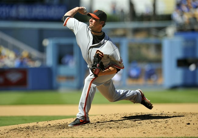 September 15, 2013; Los Angeles, CA, USA; San Francisco Giants starting pitcher Ryan Vogelsong (32) pitches during the fifth inning against the Los Angeles Dodgers at Dodger Stadium. Mandatory Credit: Gary A. Vasquez-USA TODAY Sports