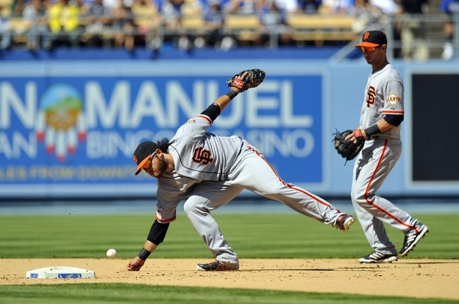 September 15, 2013; Los Angeles, CA, USA; San Francisco Giants shortstop Brandon Crawford (35) is unable to field a hit in the fifth inning against the Los Angeles Dodgers at Dodger Stadium. Mandatory Credit: Gary A. Vasquez-USA TODAY Sports
