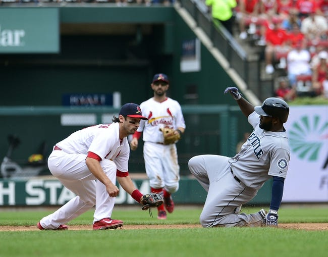 Sep 15, 2013; St. Louis, MO, USA; Seattle Mariners right fielder Abraham Almonte (36) slides into second base safely with a double as St. Louis Cardinals second baseman Matt Carpenter (13) applies the late tag at Busch Stadium. The Cardinals defeated the Mariners 12-2. Mandatory Credit: Scott Rovak-USA TODAY Sports