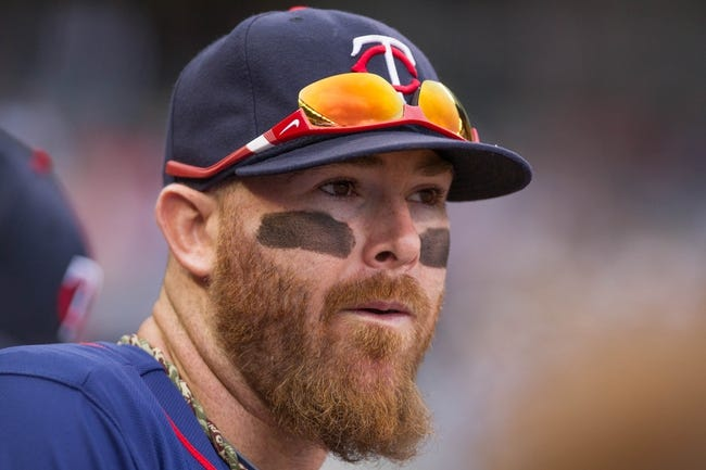 Sep 15, 2013; Minneapolis, MN, USA; The Minnesota Twins designated hitter Ryan Doumit (9) in the dugout before the game  against the Tampa Bay Rays at Target Field. Twins win 6-4. Mandatory Credit: Brad Rempel-USA TODAY Sports